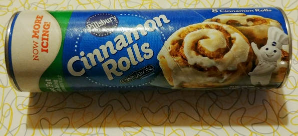 a can of cinnamon rolls for making into donuts