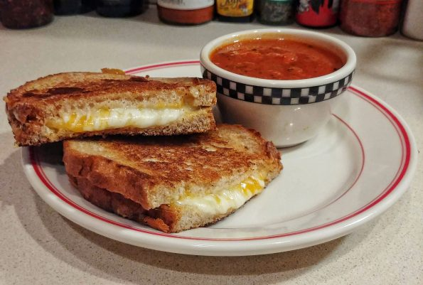 grilled cheese roasted tomato soup mozzarella cheddar muenster phil collins philip bailey