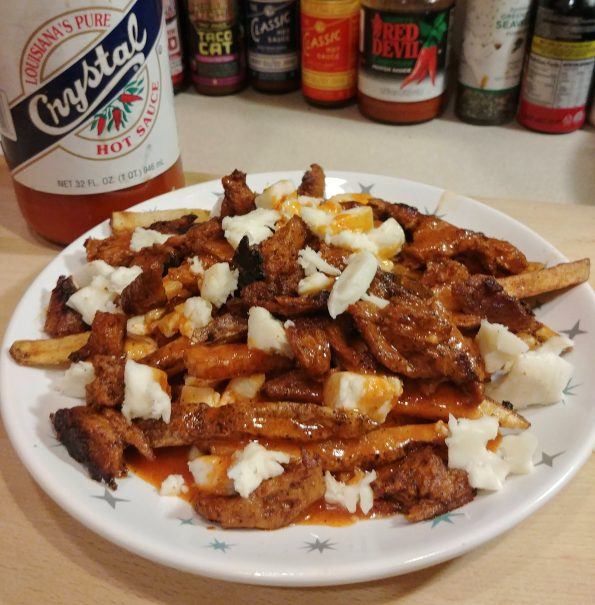 poutine fries chickwheat buffalo spice sauce cheese taco